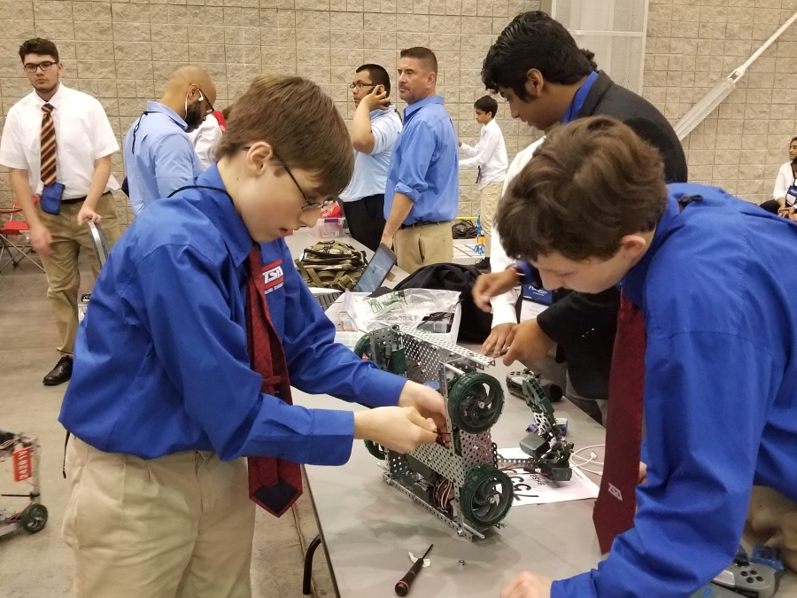 VEX Team 1 - 3 members of the Battlefield TSA Chapter VEX Robotics team preparing for competition during Technosphere 2019.